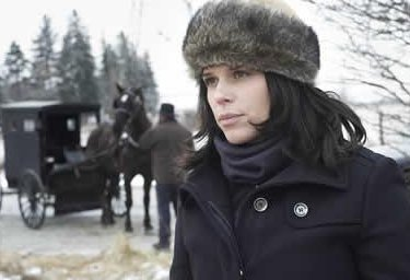 Neve Campbell as Kate Burkholder in An Amish Murder